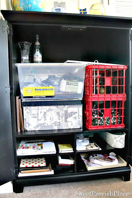 TV cabinet repurposed as craft storage
