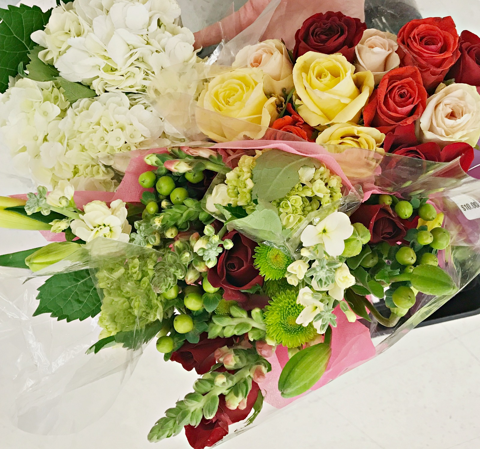 Diy prom bouquet sweet parrish place i ended up purchasing three different bunches of flowers some hydrangea some roses and then a bunch that had red roses and various other things izmirmasajfo
