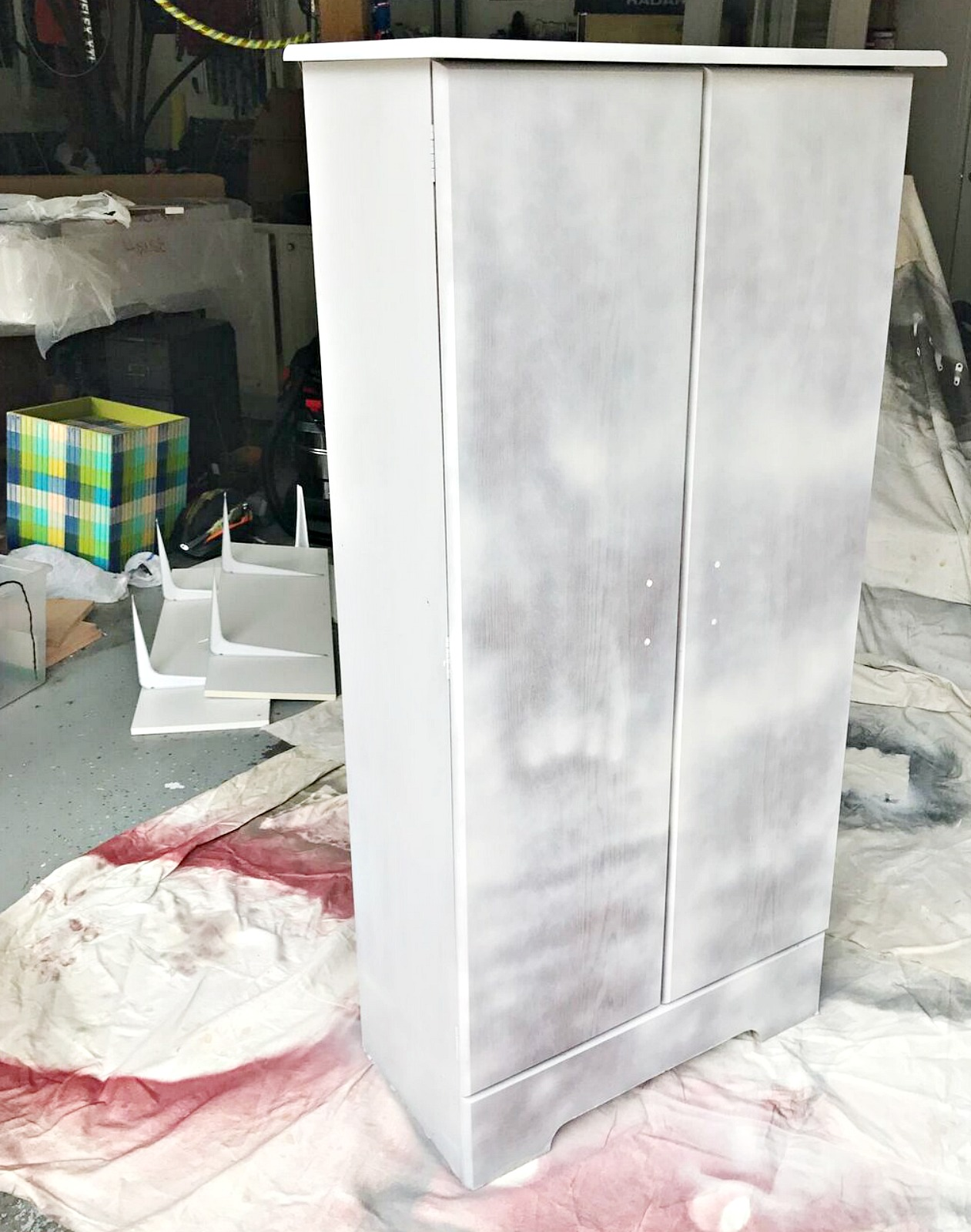spray painting a laminate cabinet with chalked paint