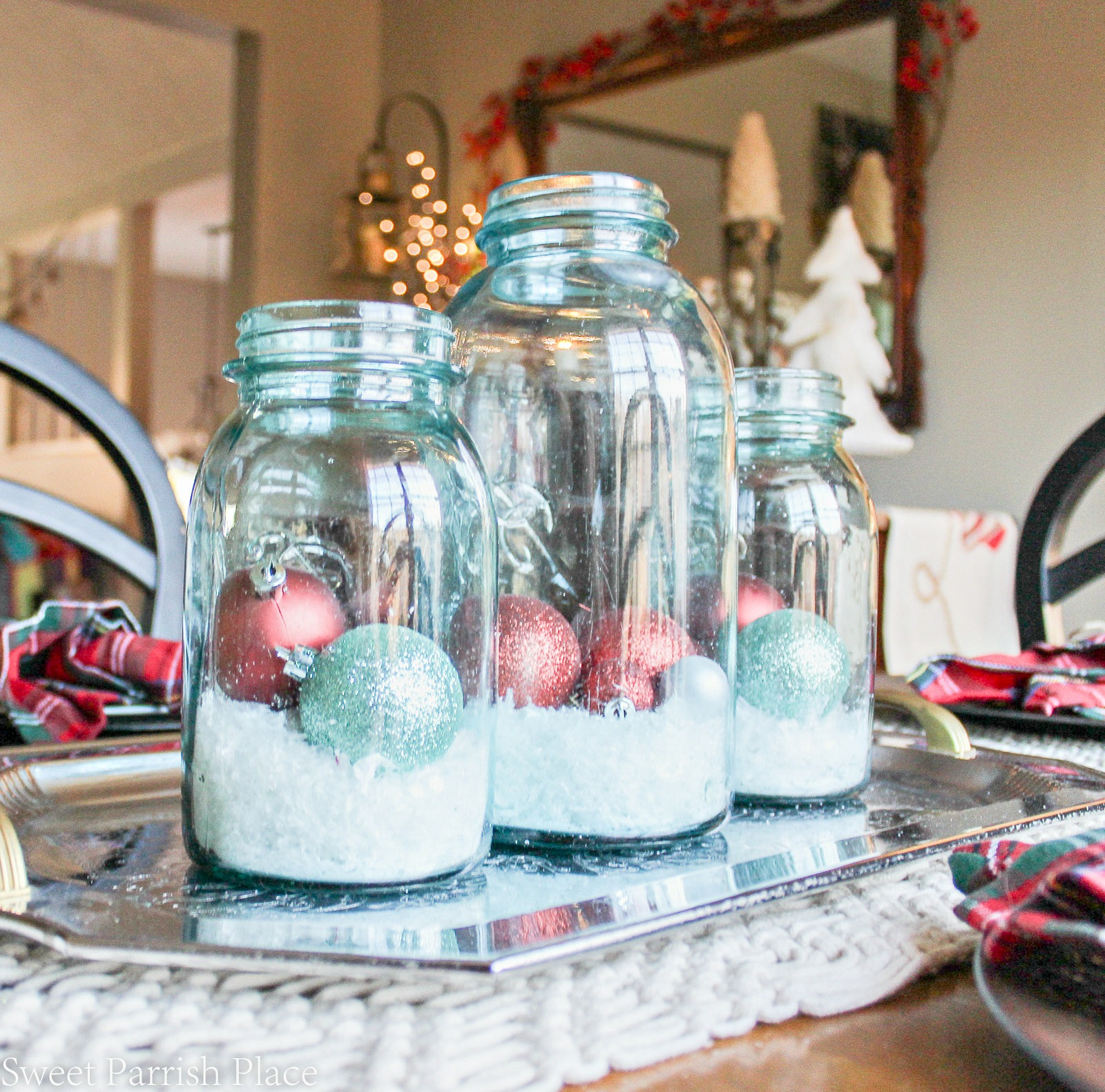 blue ball jars with snow and ornaments