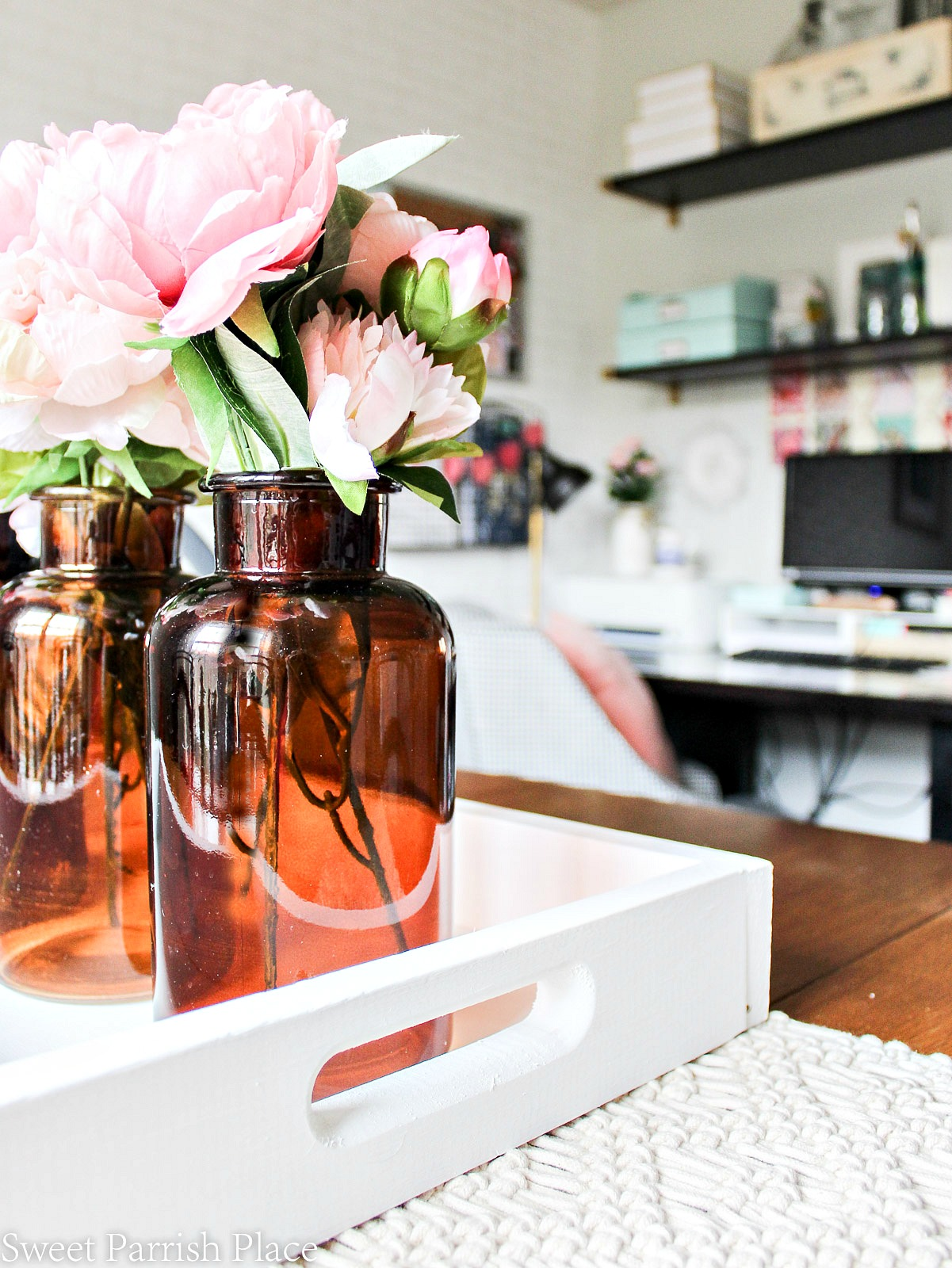 amber bottles with peonies
