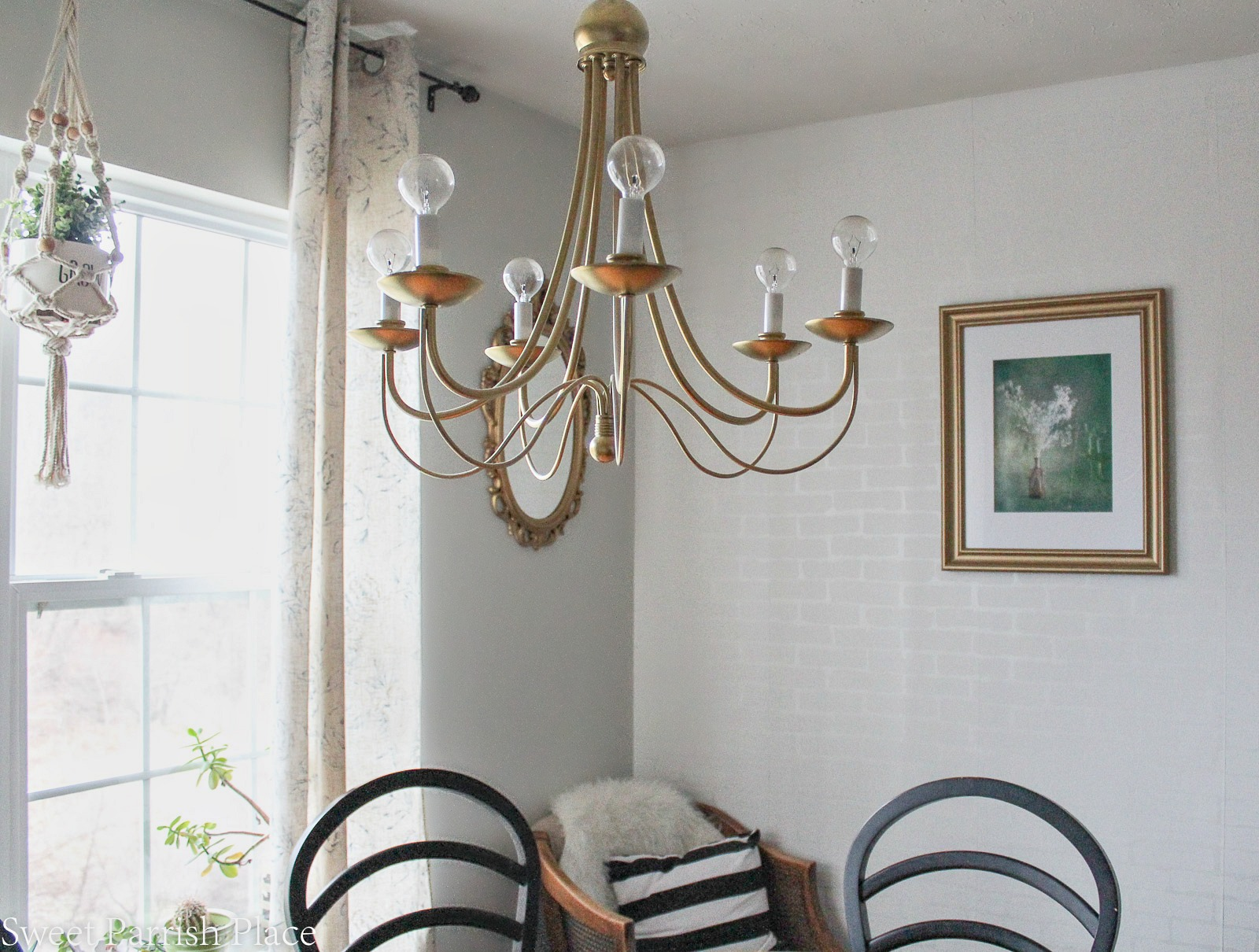 gold chandelier and wall art