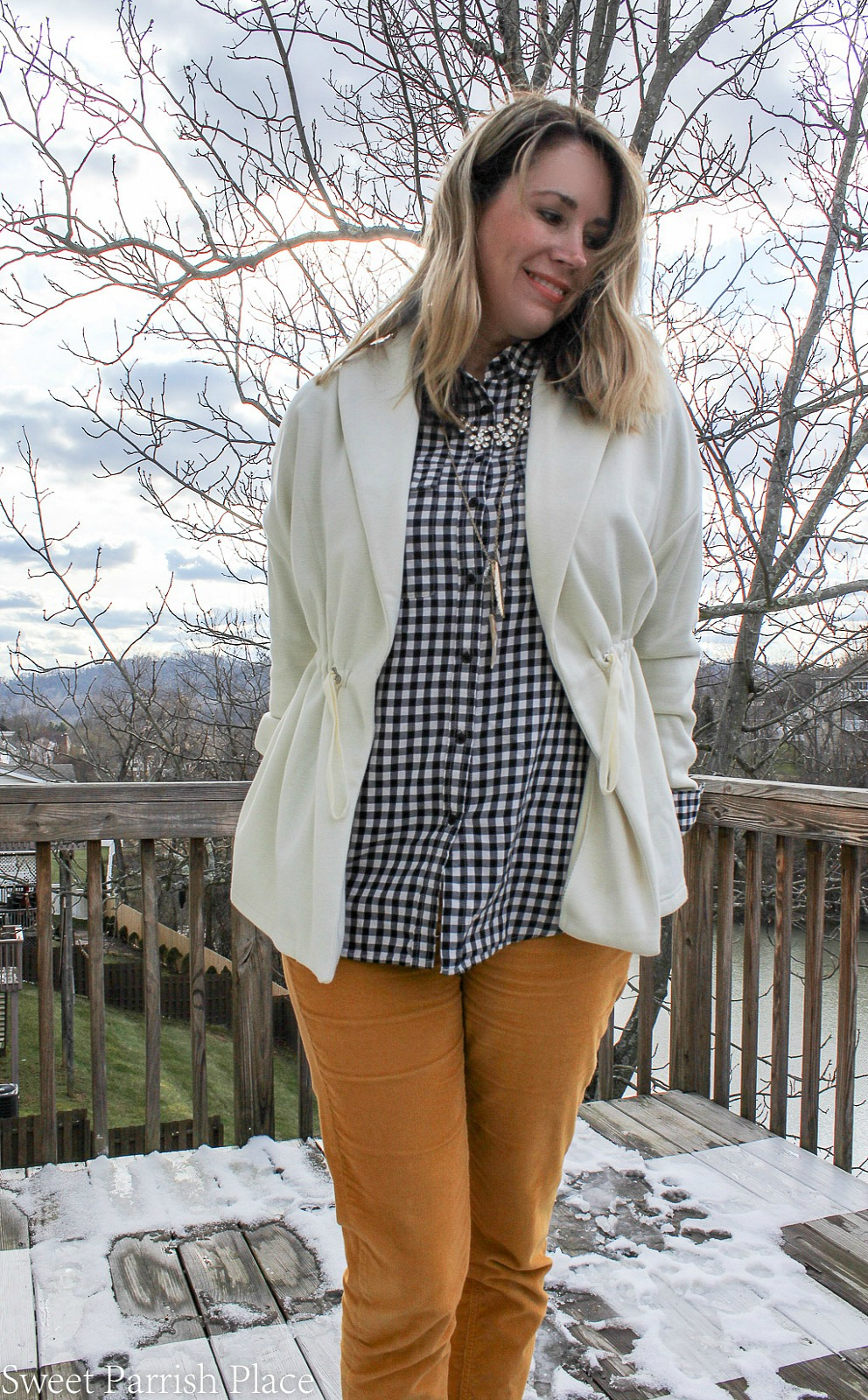 Fabletics sage coat with mustard pants and plaid button down