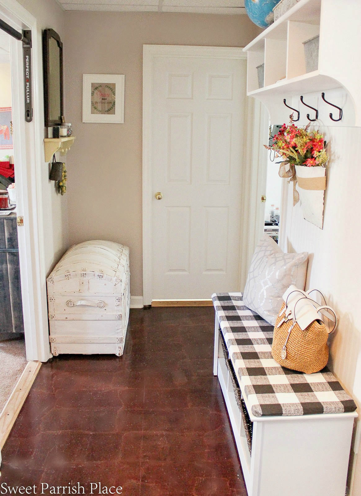 mudroom with vintage trunk
