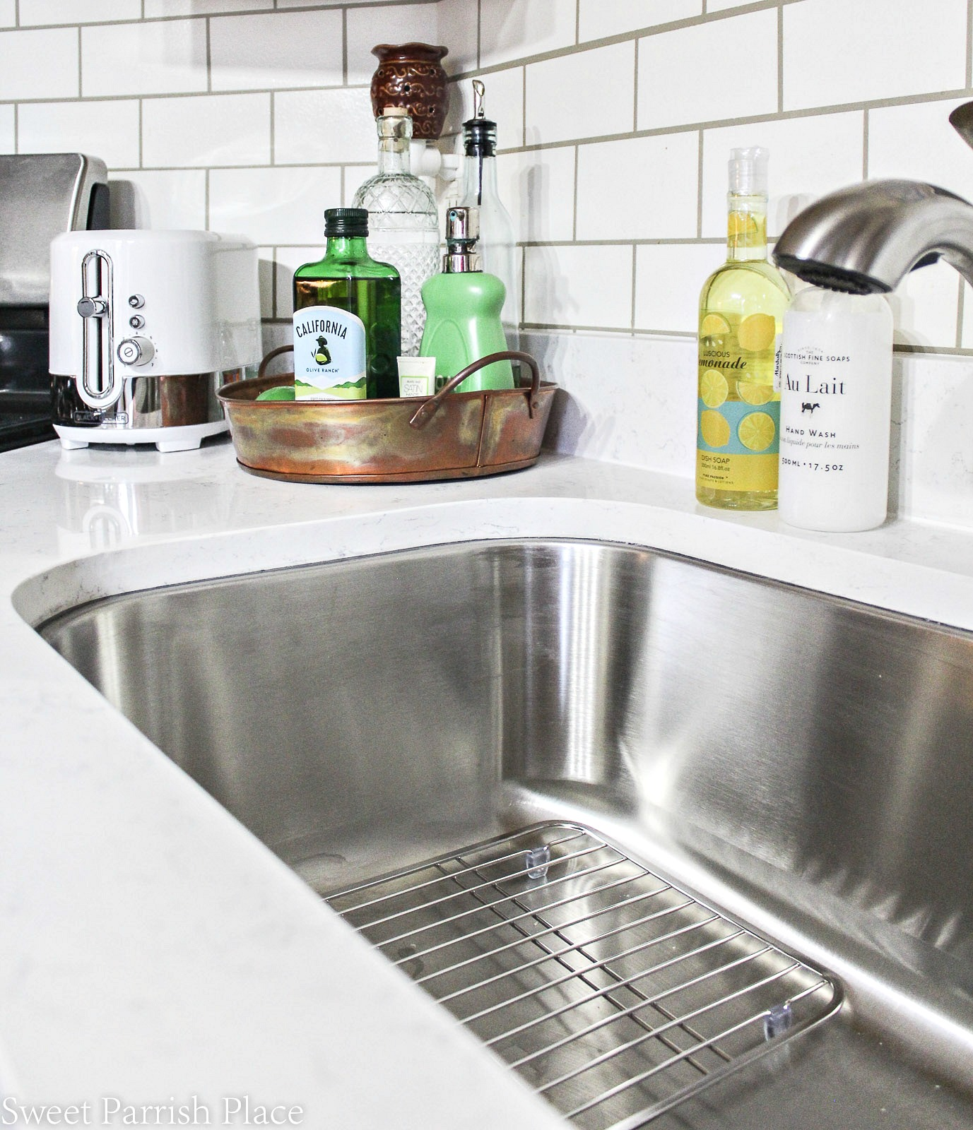 new quartz countertops with stainless steel sink