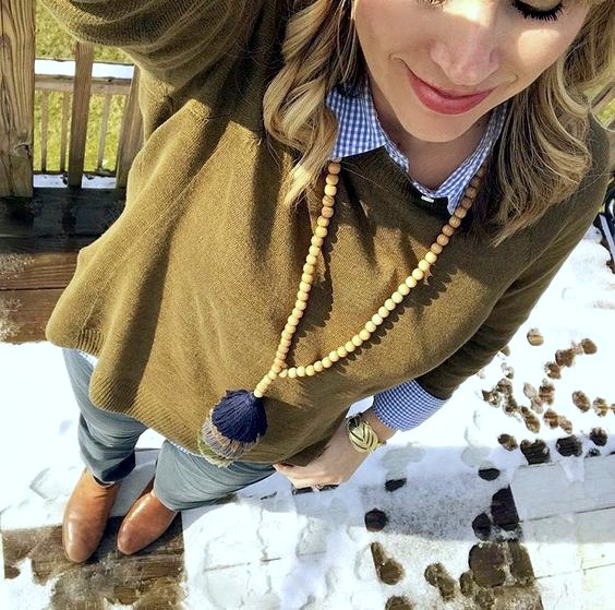 olive sweater with tassel necklace