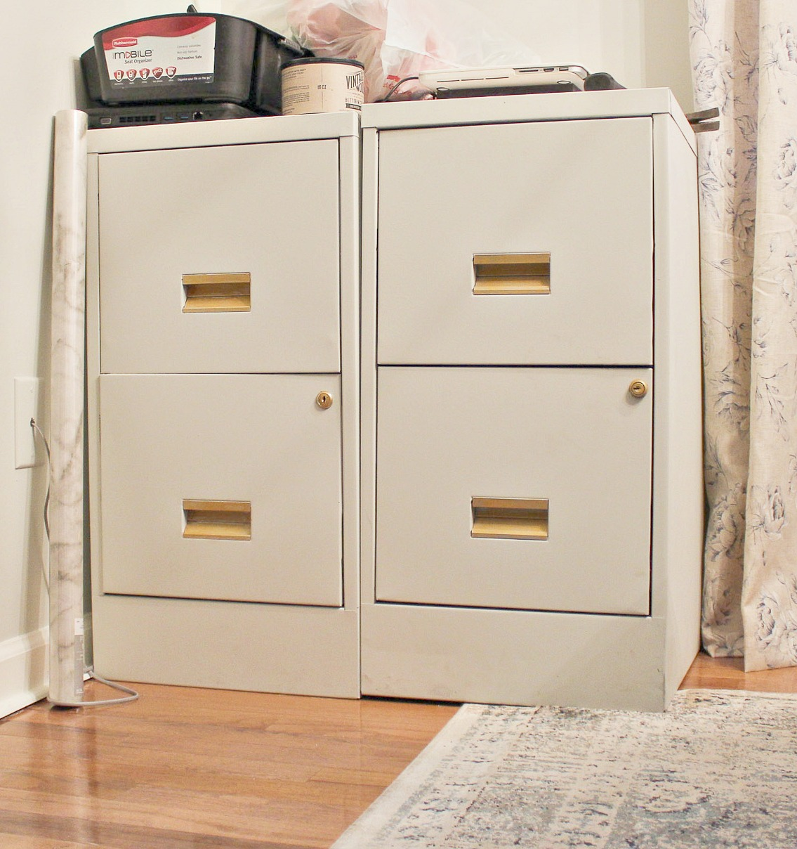 gold pulls on metal filing cabinet