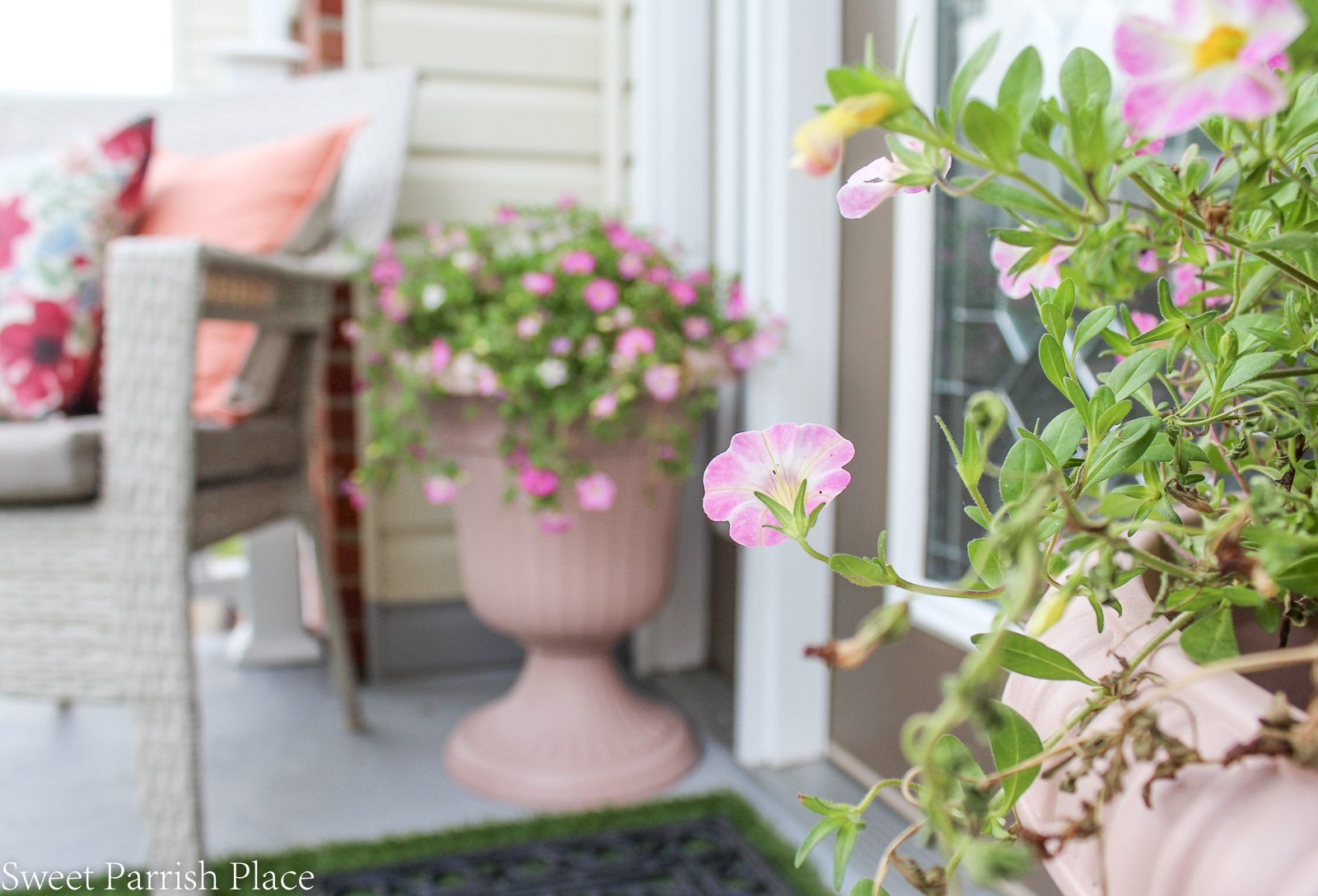 blush planters with pink flowers