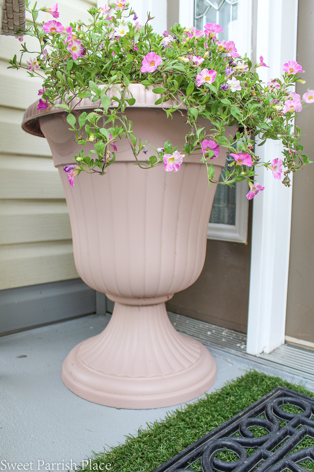 wild rose painted urns with pink flowers