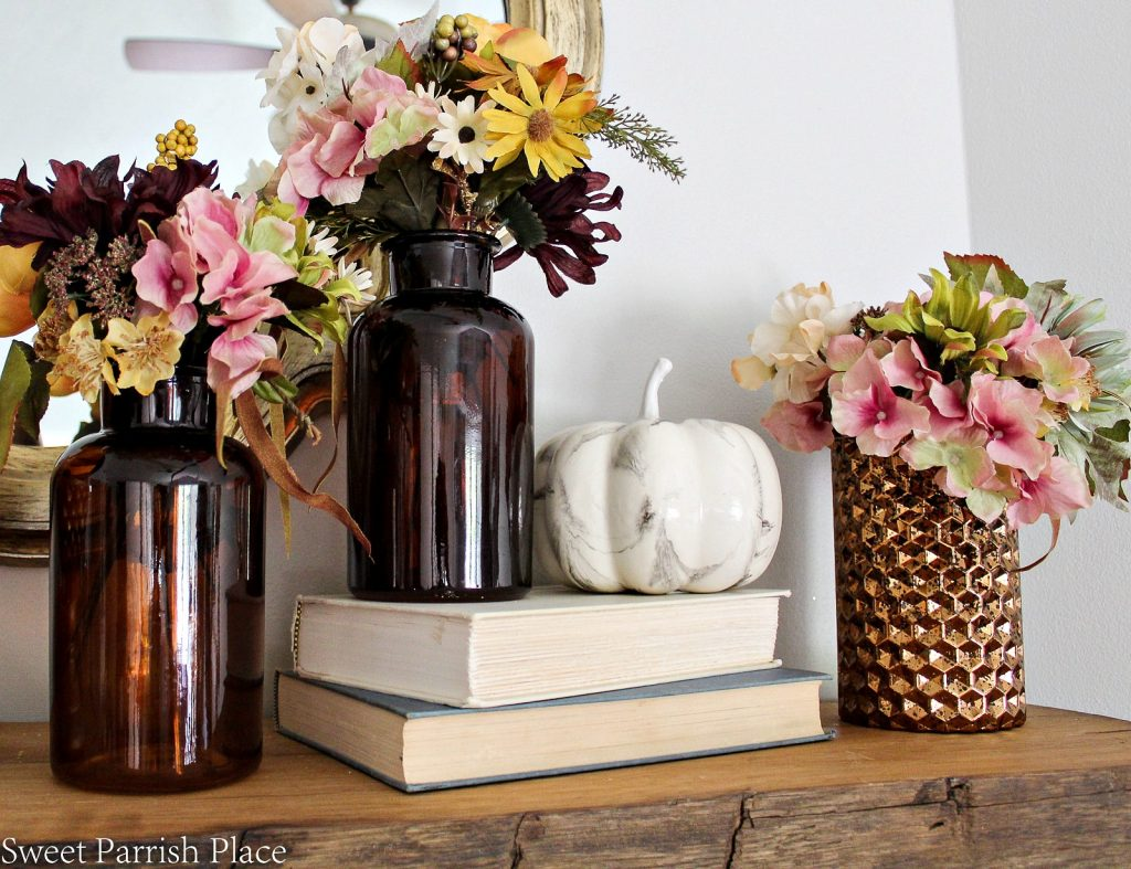 amber bottles with fall arrangements