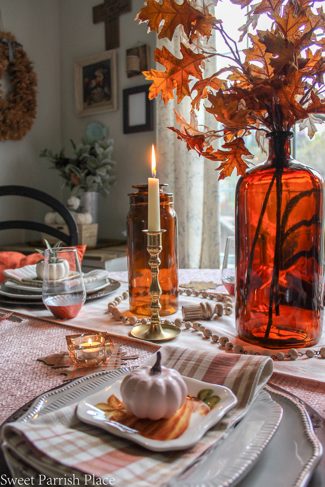 cozy blush and amber thanksgiving tablescape