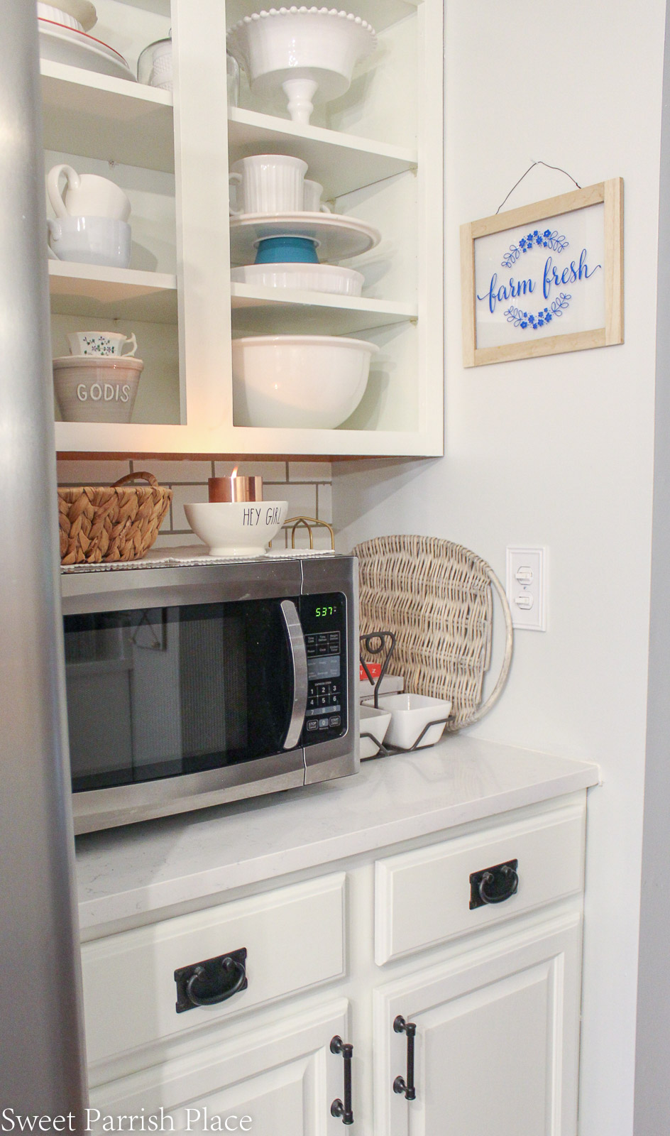 open shelving created by removing cabinet doors
