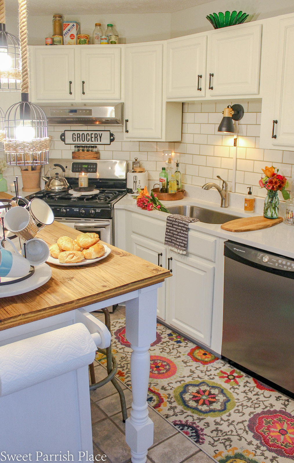 modern farmhouse kitchen with white cabinets and pops of color