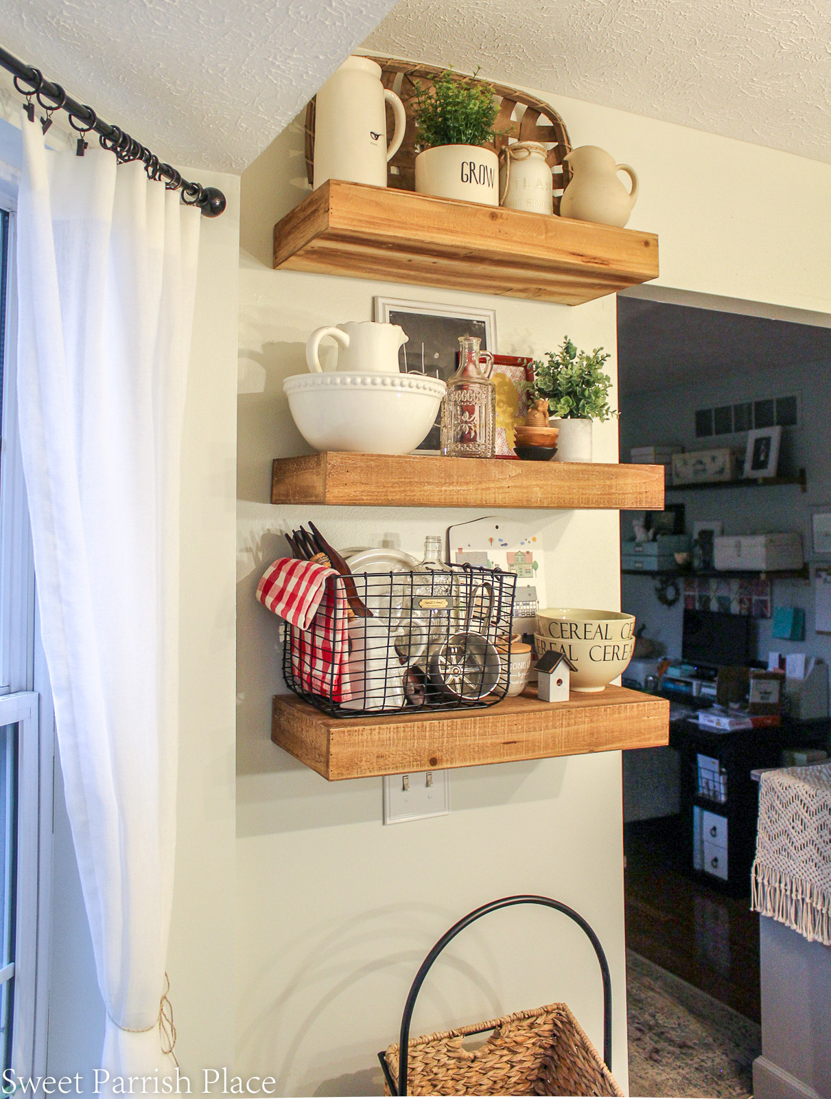 floating shelves in modern farmhouse kitchen