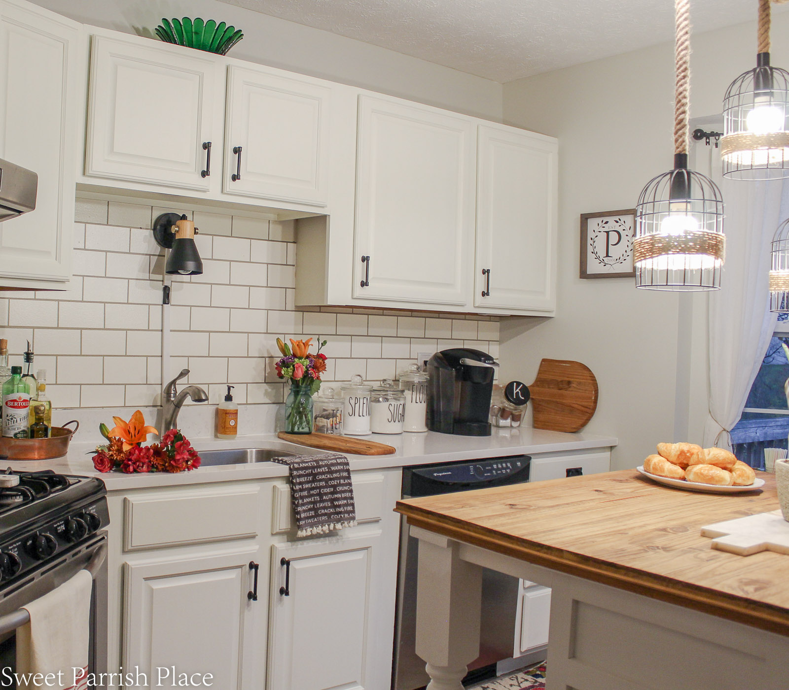 modern farmhouse kitchen with walls painted in gray owl by Benjamin Moore