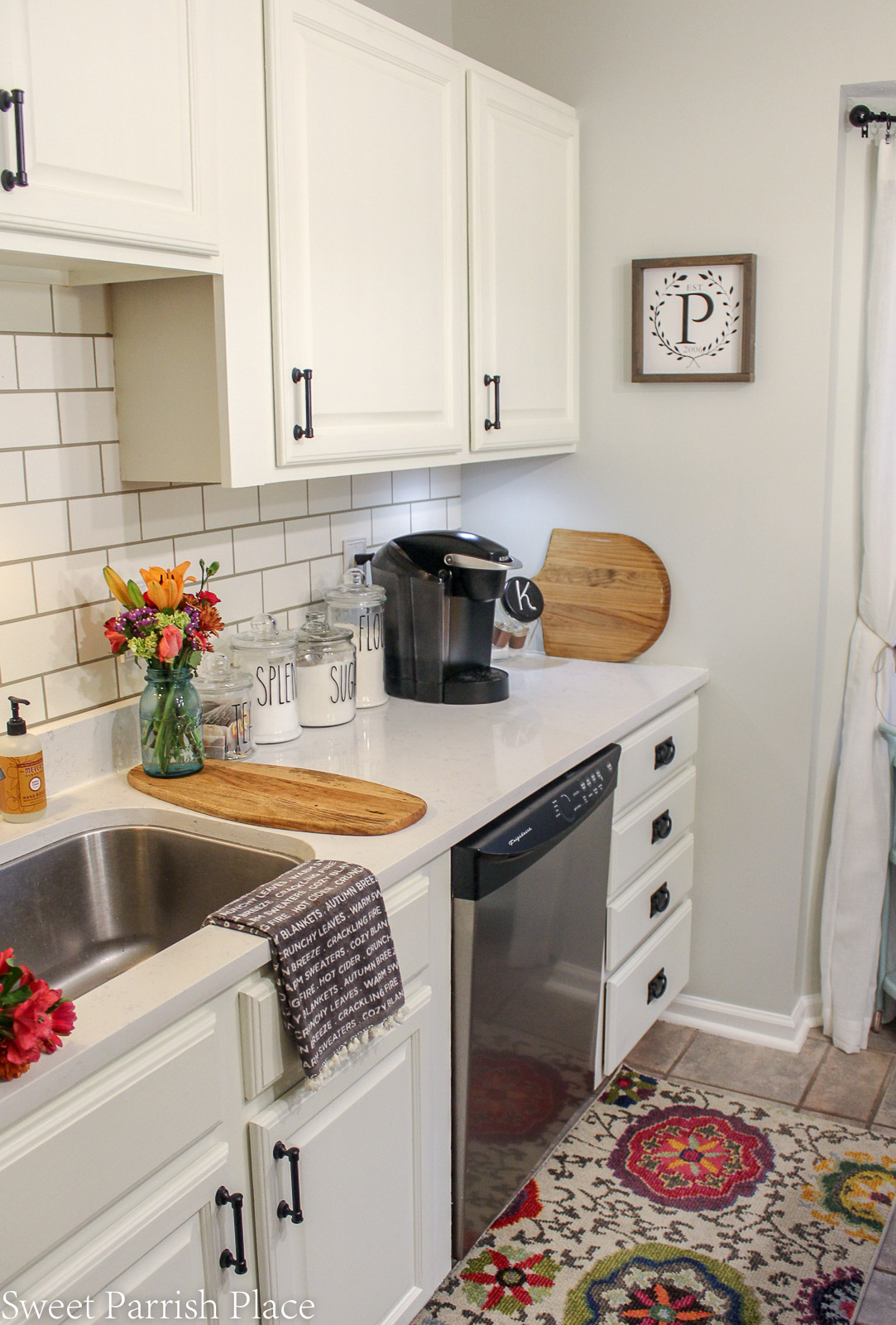 kitchen cabinets painted in simply white by Benjamin Moore
