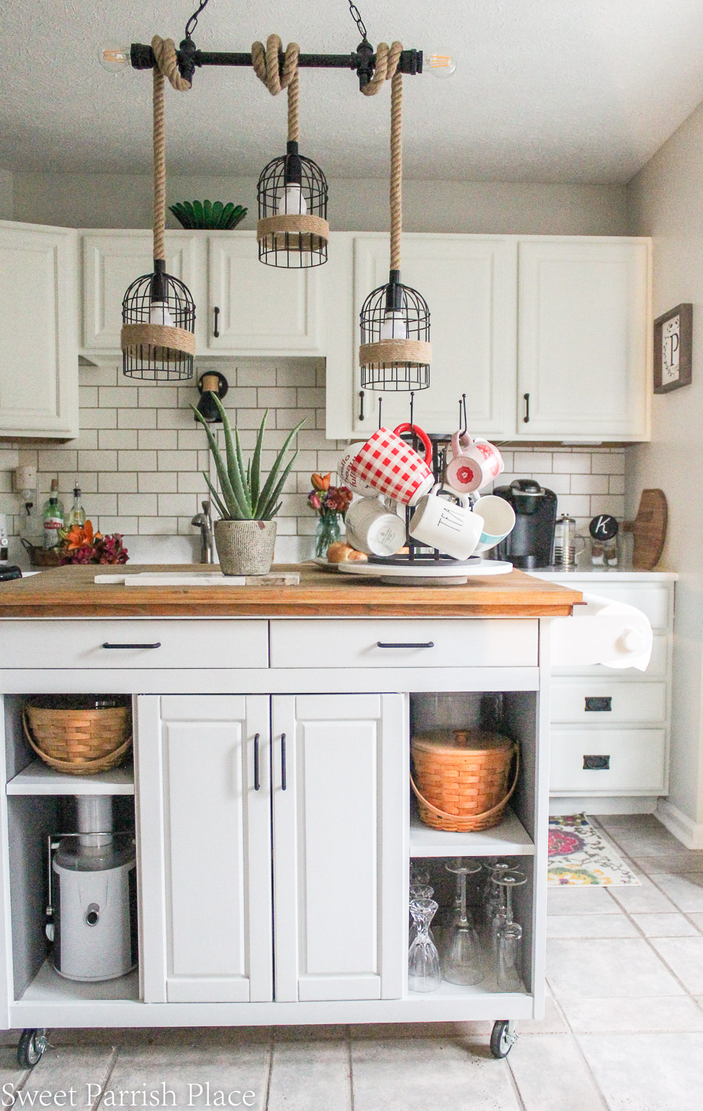 modern farmhouse kitchen with white cabinets and warm wood tones