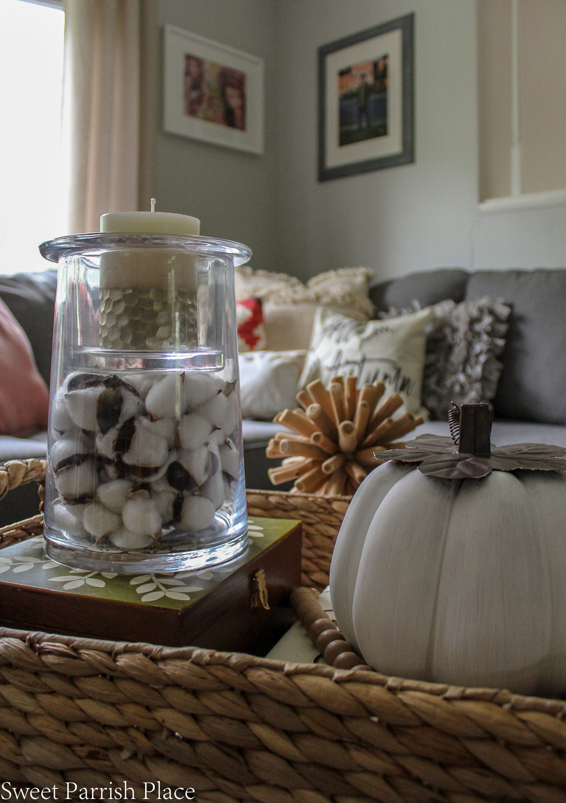 cotton pods in glass candle holder