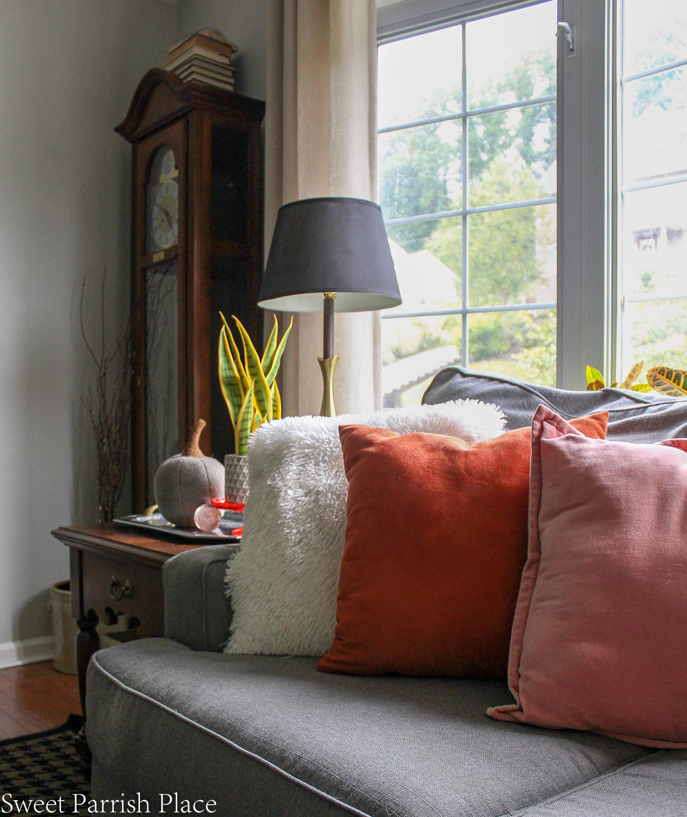 blush, rust, and cream pillows