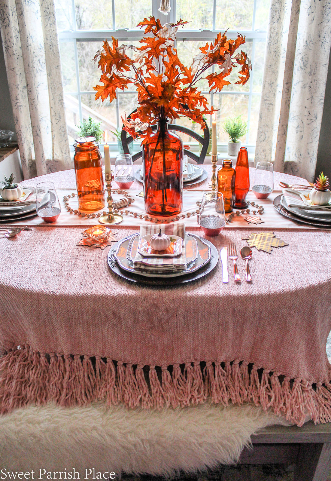 amber bottle centerpiece for fall tablescape