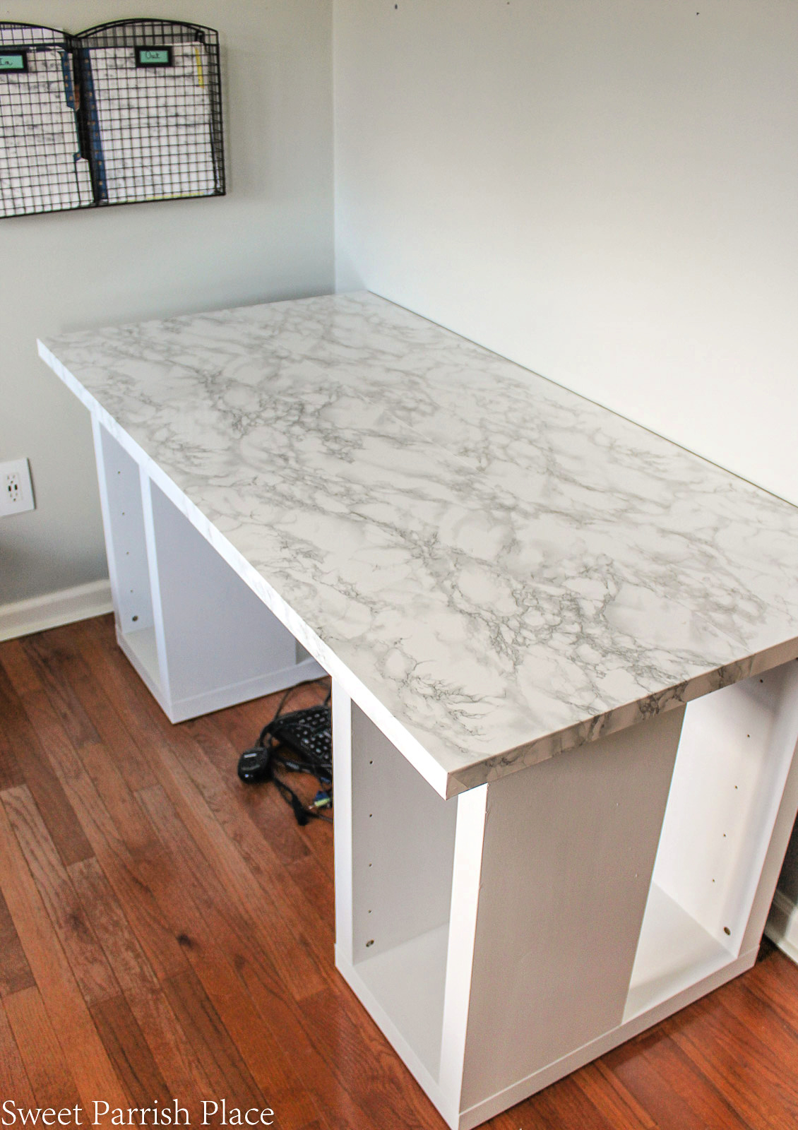 Ikea desk top with marble contact paper applied