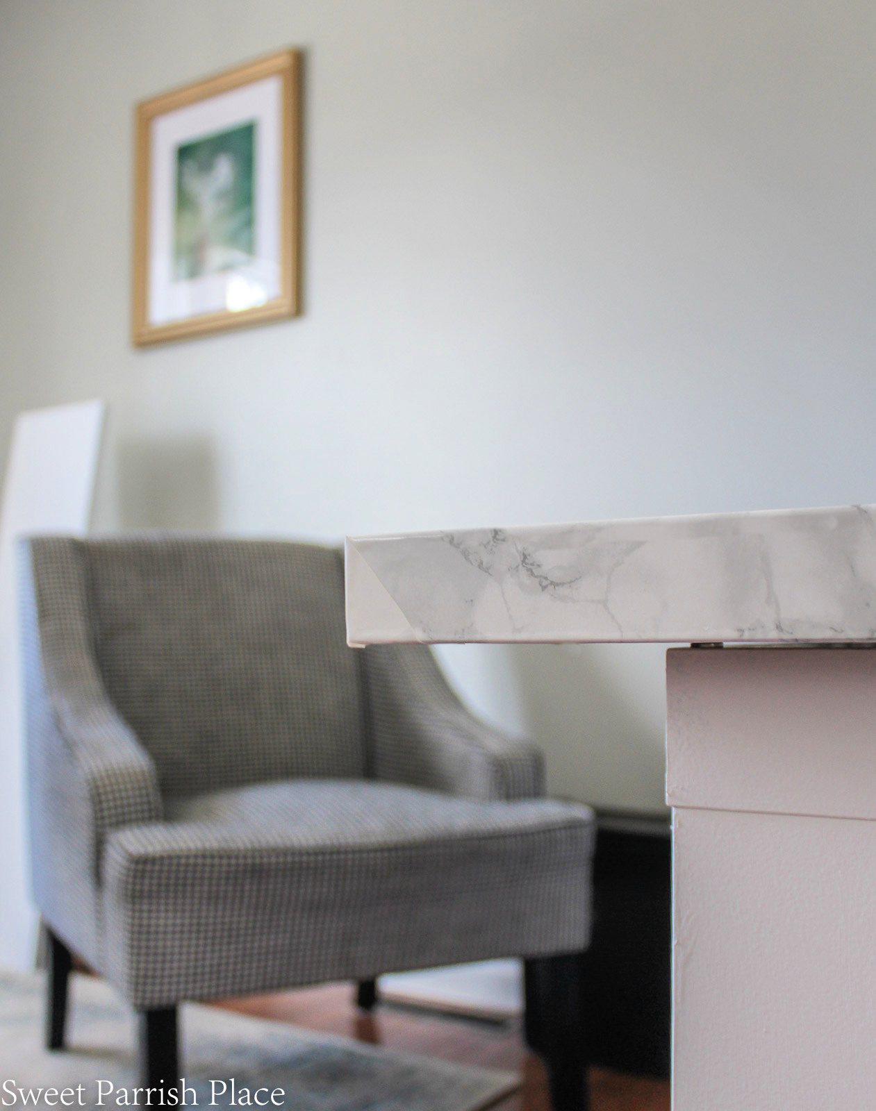 marble contact paper on Ikea desk- wrapped corners