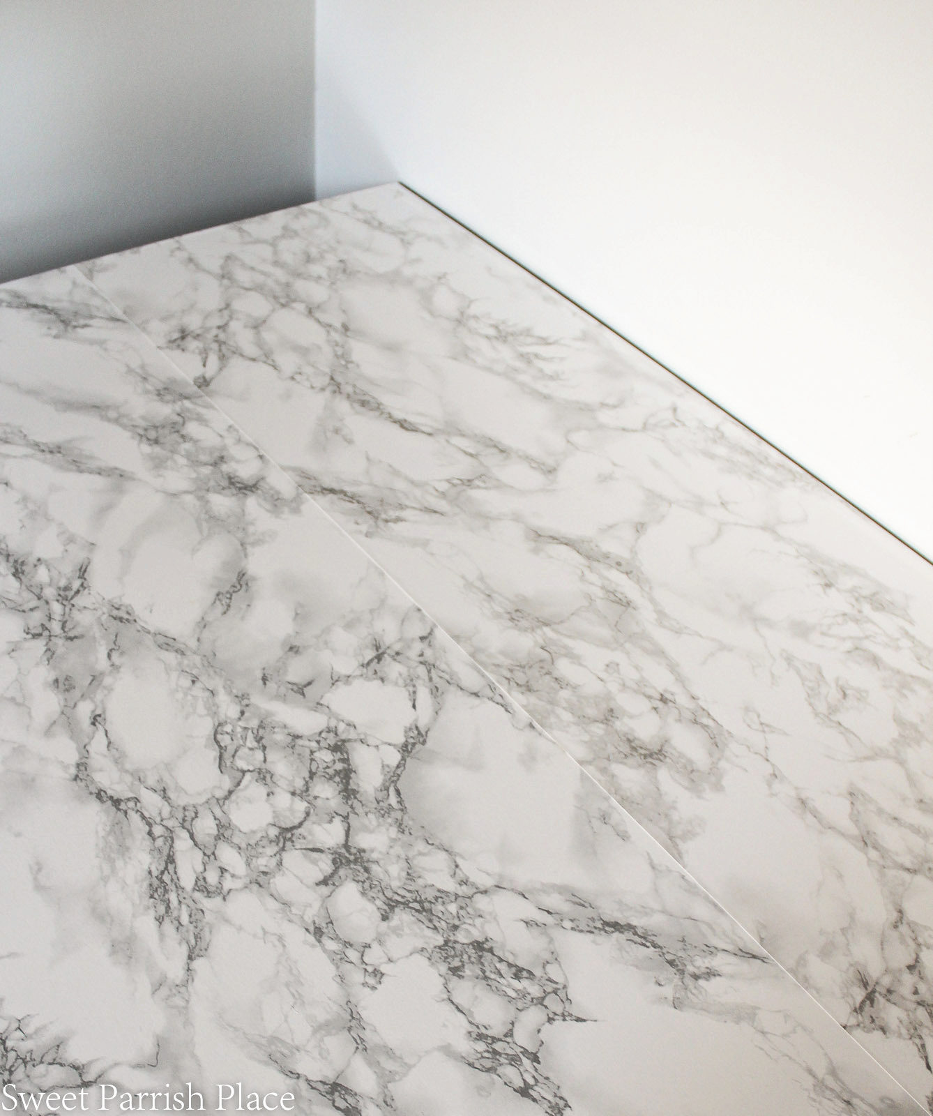marble contact paper seam on desk top
