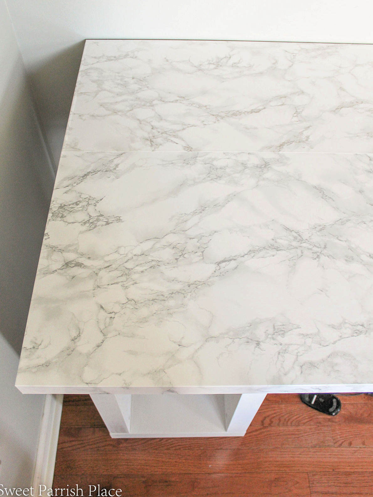 making over a desk top with marble contact paper