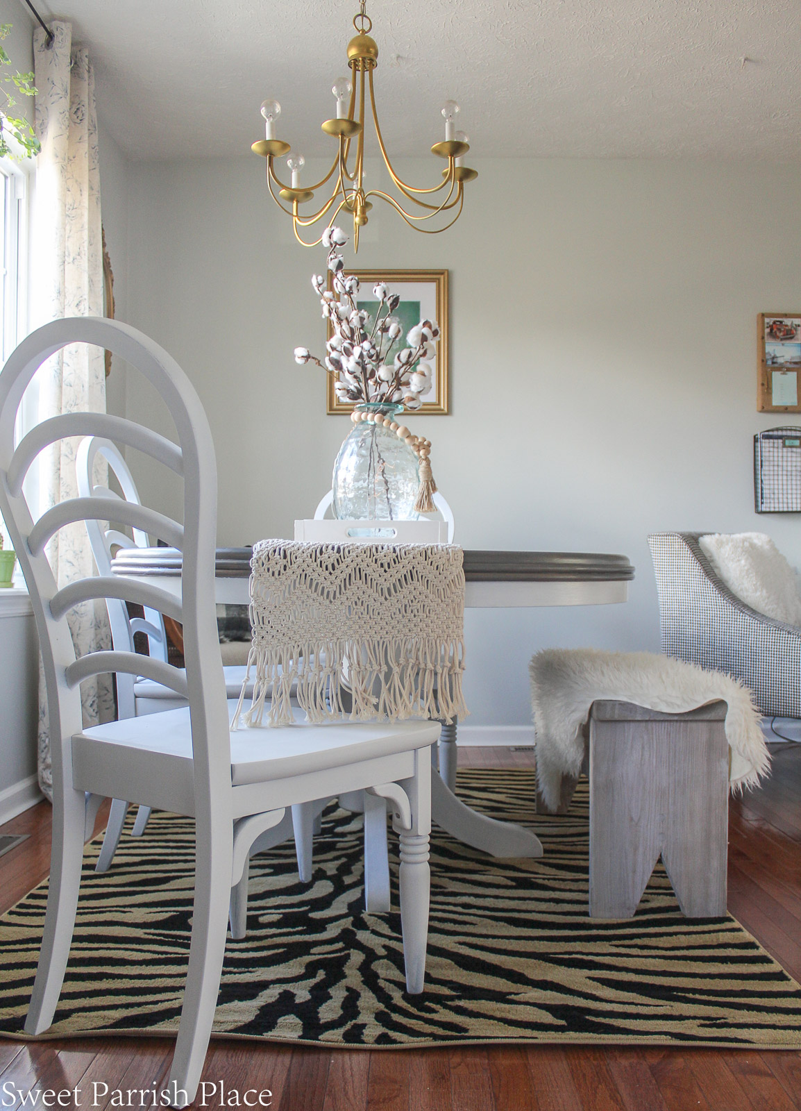 weathered grey dining table makeover - side of table with white chair