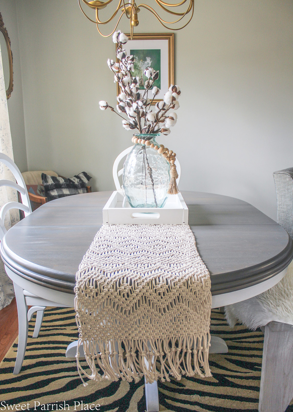 Modern Farmhouse Dining Room with weathered gray table top and macrame runner from World Market