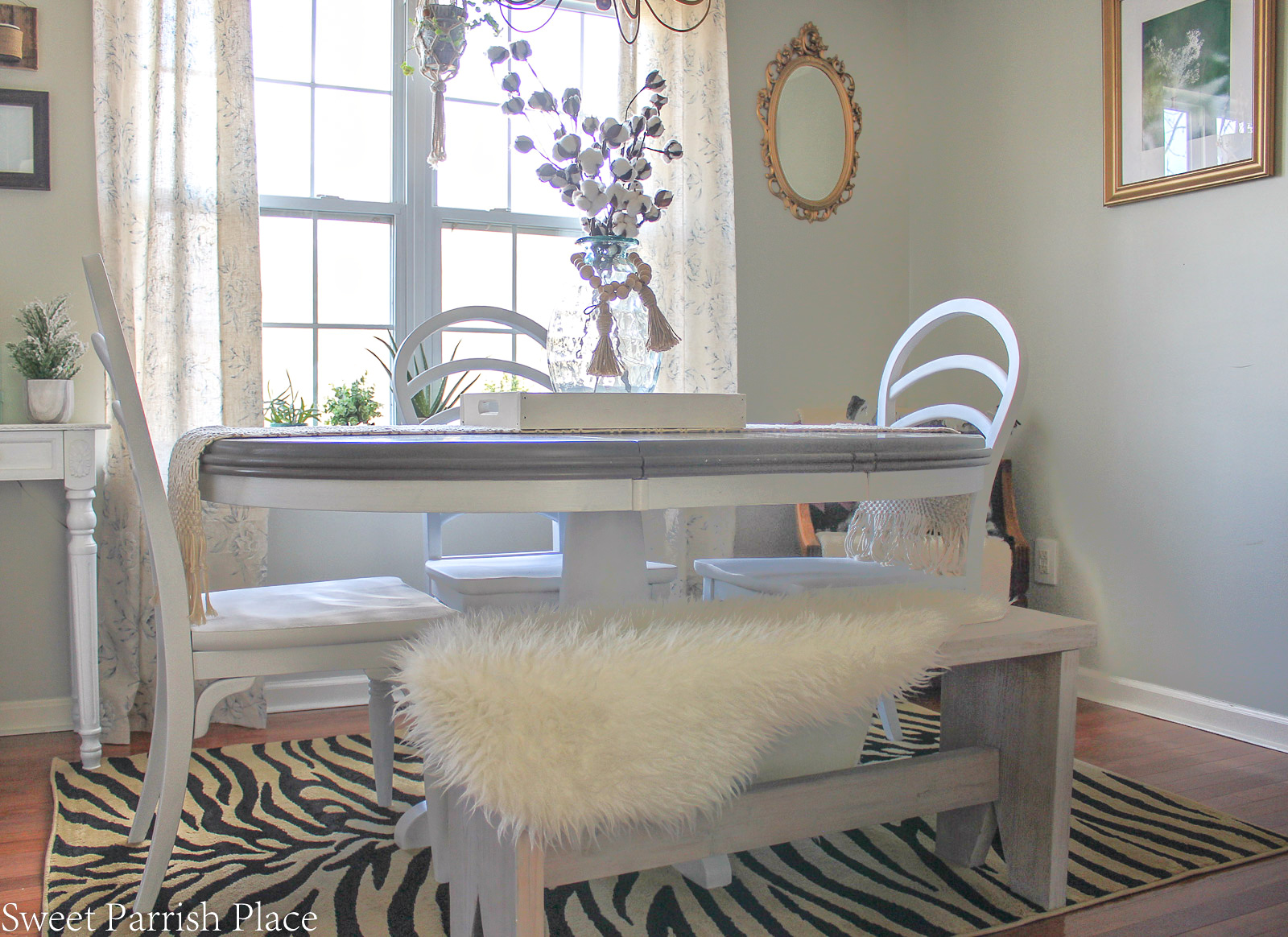weathered grey dining table makeover with white base and chairs