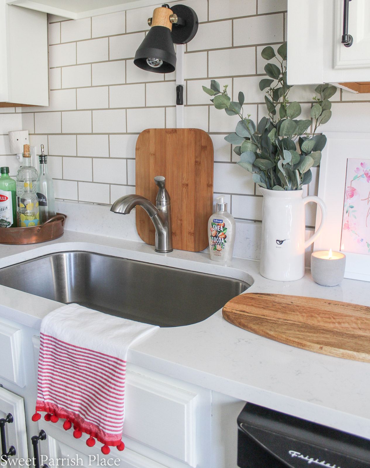 Budget Friendly Ideas to Freshen Up Your Kitchen- add faux greenery or flowers