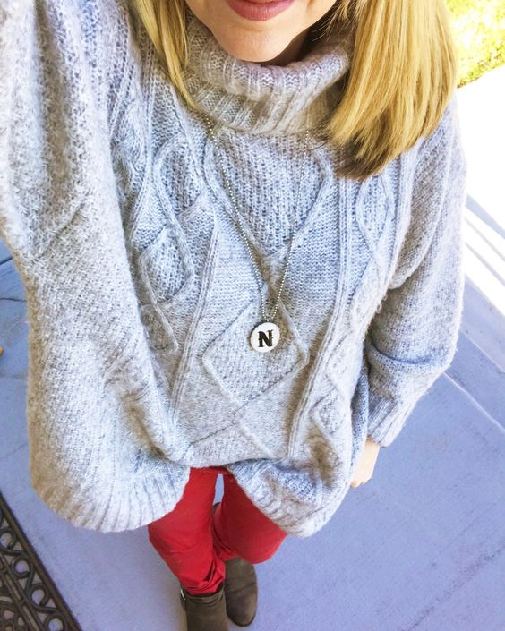 chunky grey turtleneck sweater and red jeans