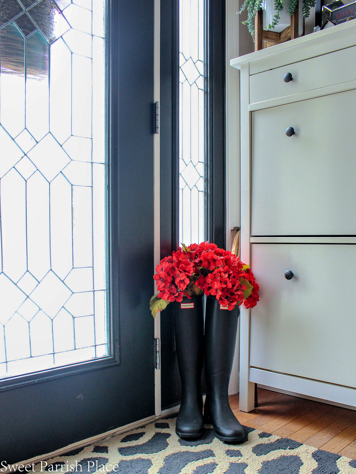 2019 Spring Entryway Hunter boots with red geraniums