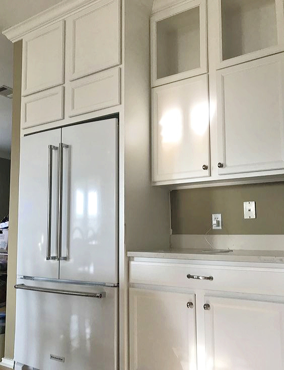 kitchen renovation progress and white refrigerator