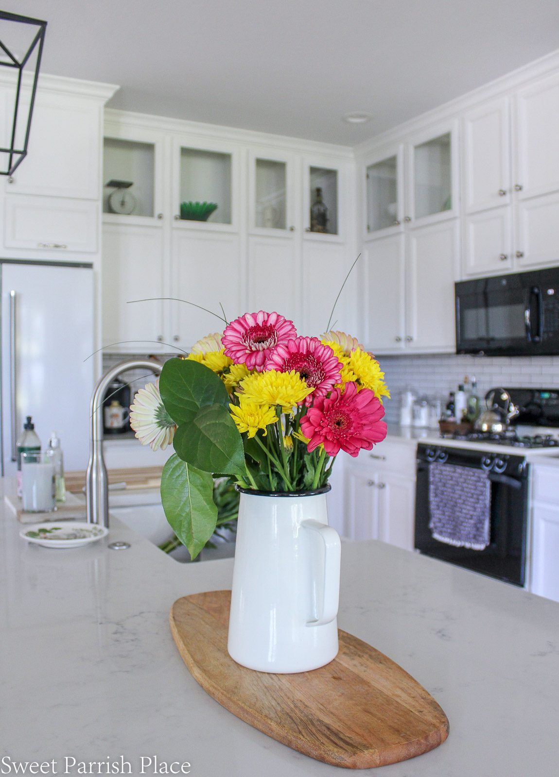 Prairie House kitchen reveal fresh flowers on counter
