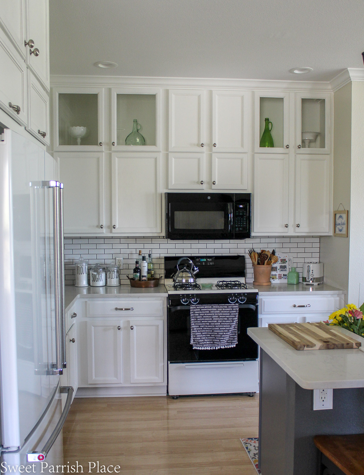 Prairie House kitchen reveal white cabinets with stove