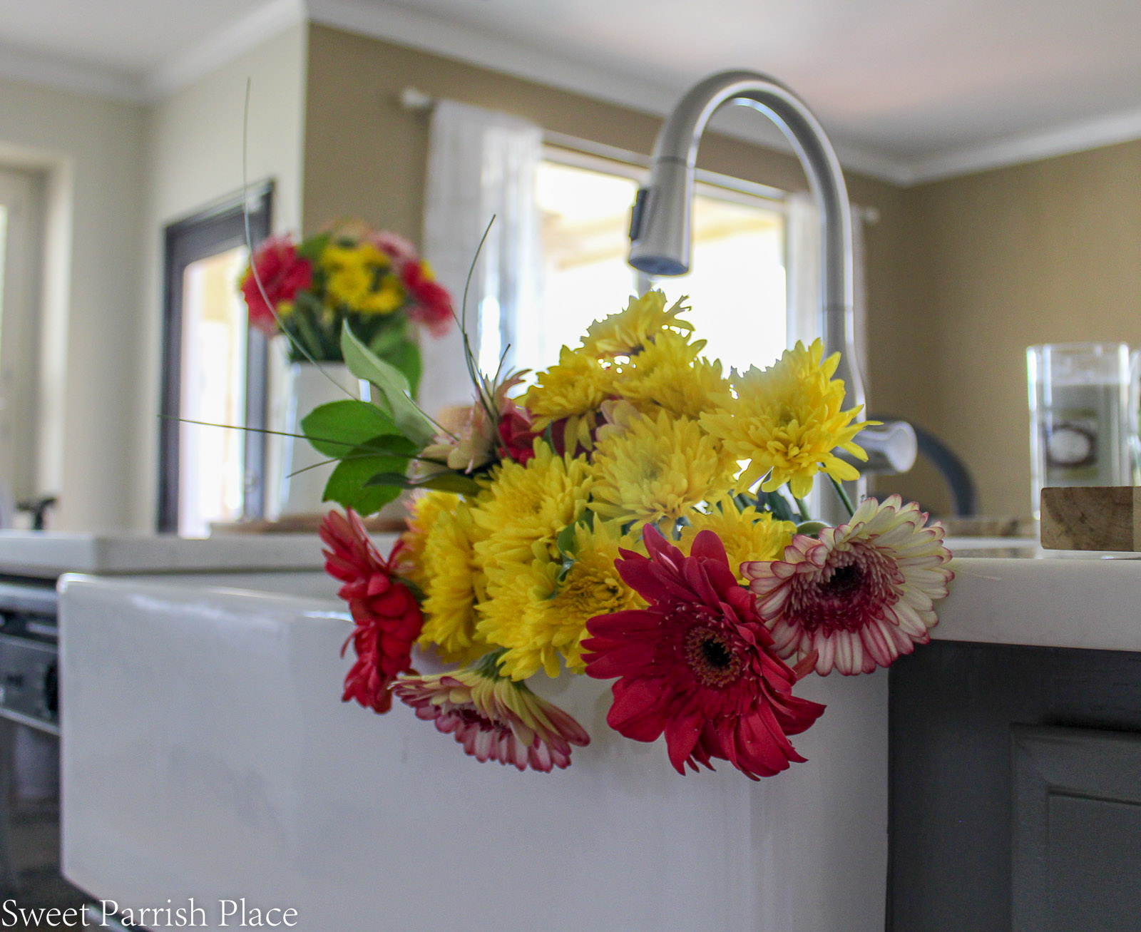 Prairie House kitchen reveal farmhouse sink with flowers