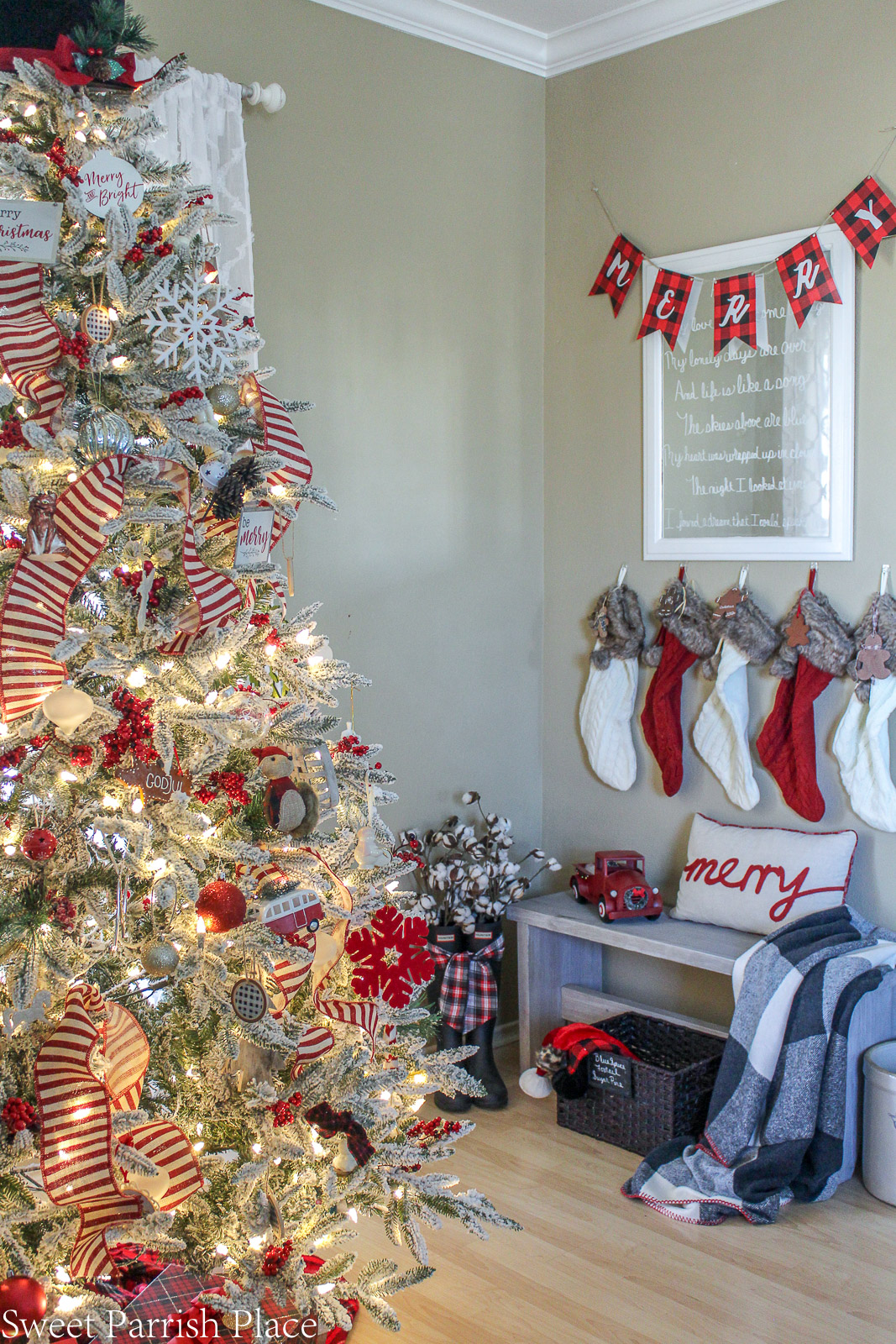 prairie house christmas tree with stockings in background