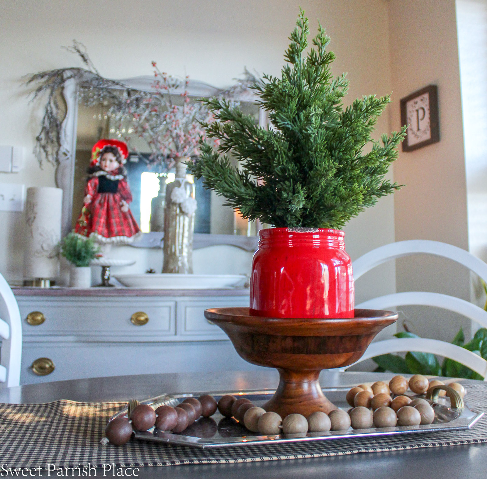 traditional Christmas breakfast room with red jar full of greenery