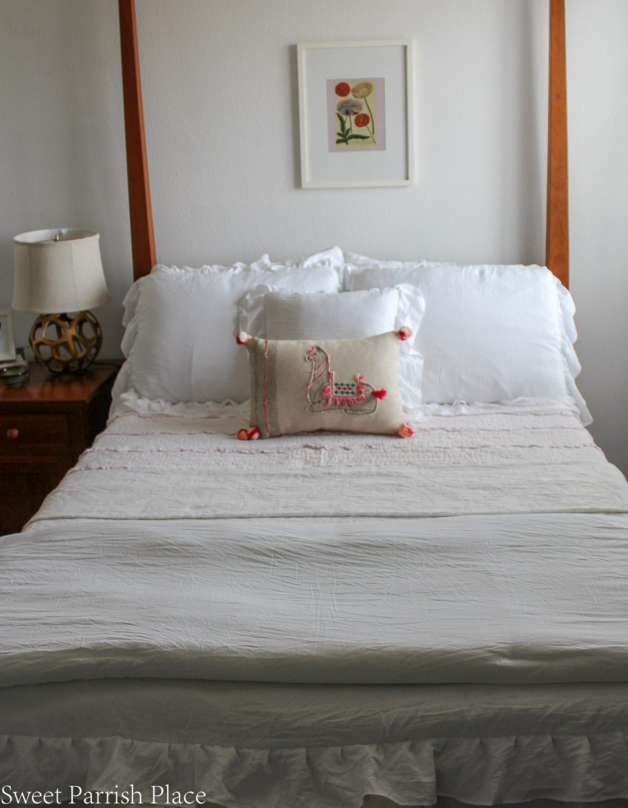 New White Bedding with pink quilt
