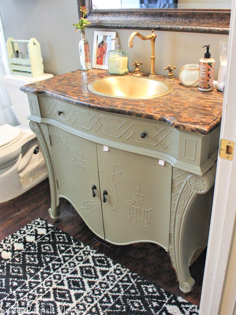 painted bathroom vanity with lights on above