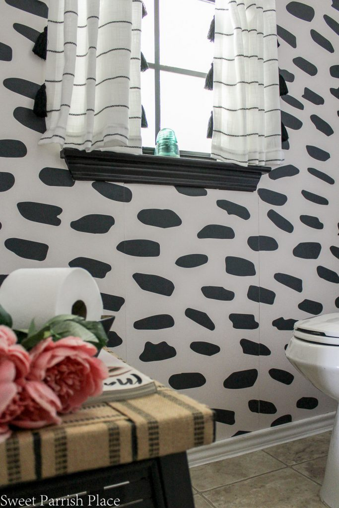 bold black and white accent wall using wallpaper from Photowall