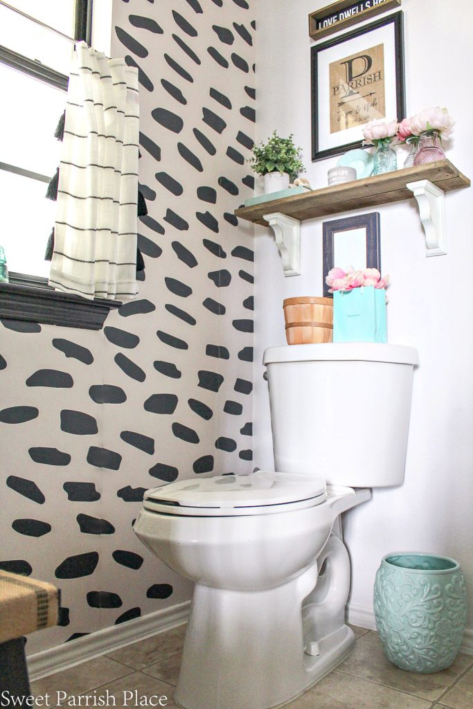 powder room refresh with wallpaper accent wall corner view