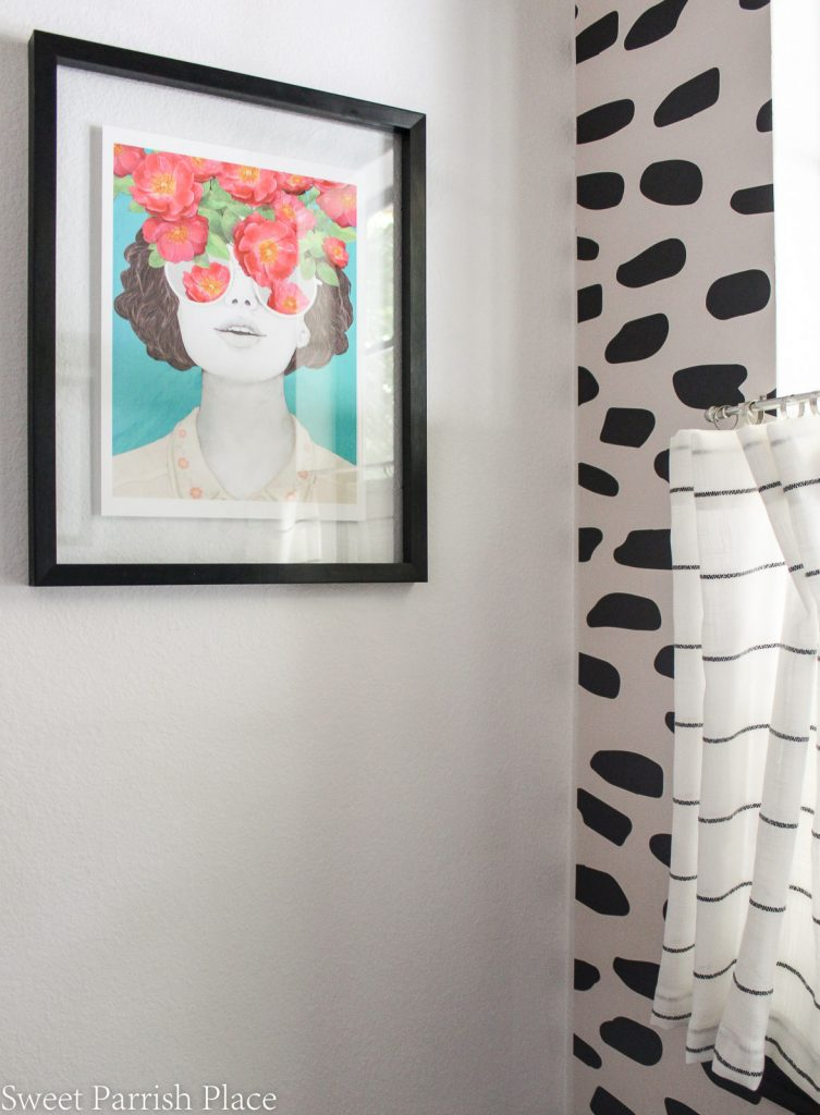 powder room refresh with colorful art print