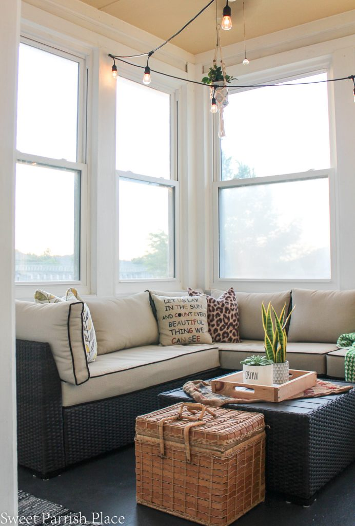 Modern Farmhouse sunroom with Ashley sectional and thrifted picnic basket