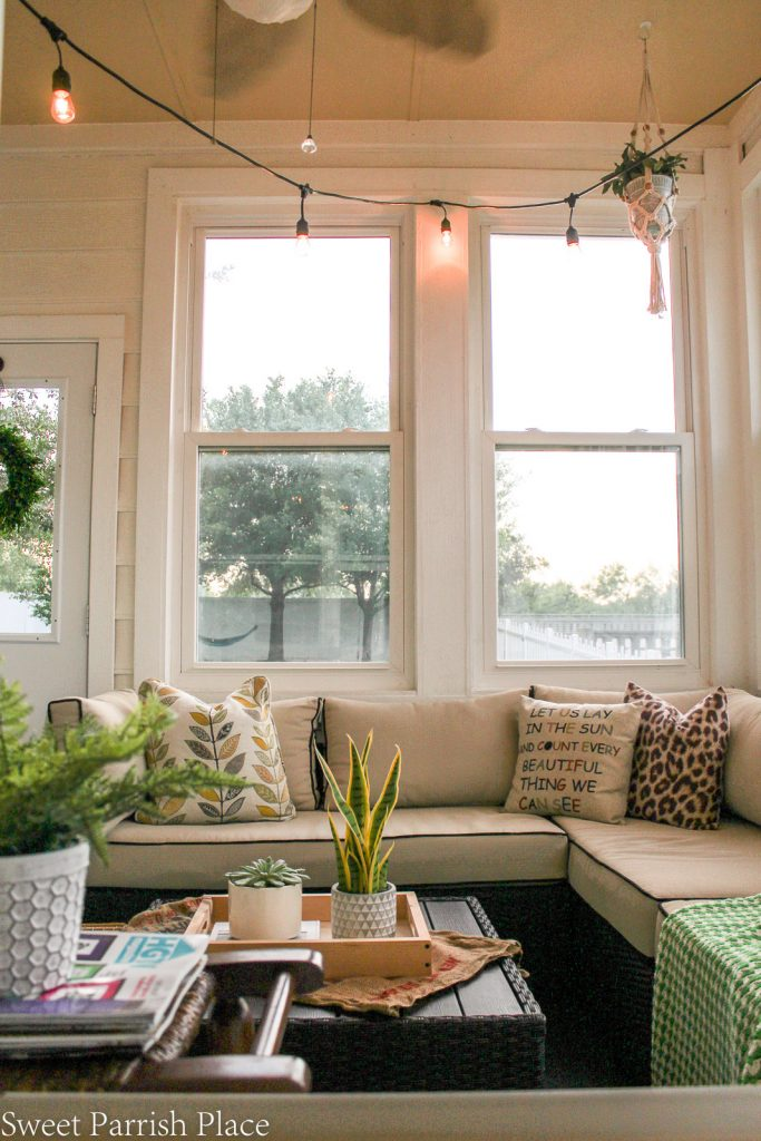 large windows in modern farmhouse sunroom
