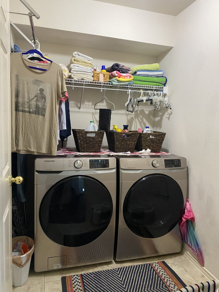 laundry room with champagne washer and dryer