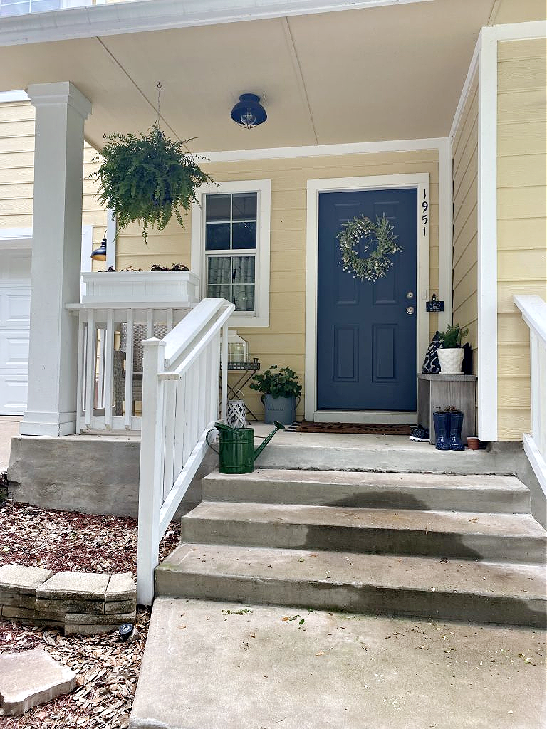 Nantucket Grey Front Door with yellow exterior One year in our Texas house