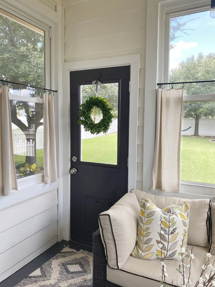 black door in sunroom One year in our Texas house